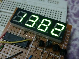 PIC16F877A with 7-segment display and shift register hardware circuit