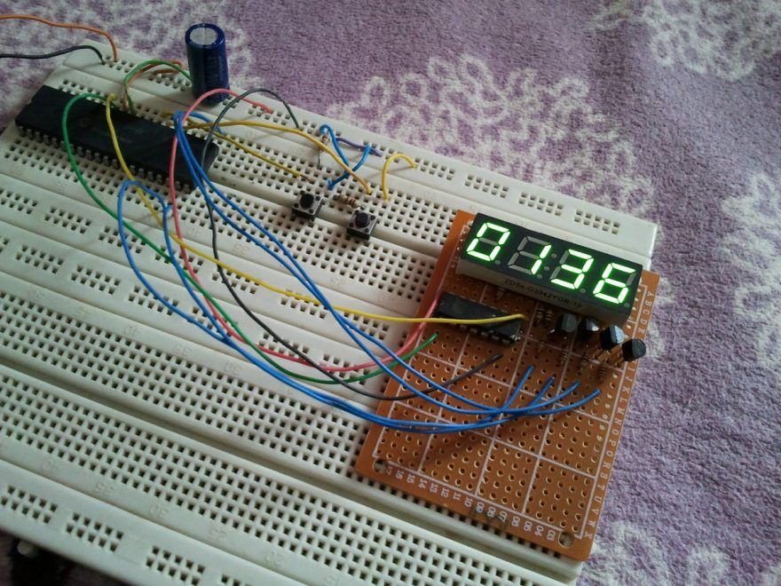 PIC18F4550 microcontroller with 7 segment shift register circuit