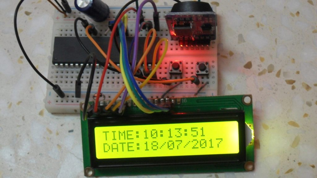 Real time clock using PIC16F887 and DS3231