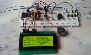 Real time clock with alarms using PIC16F877A and DS1307