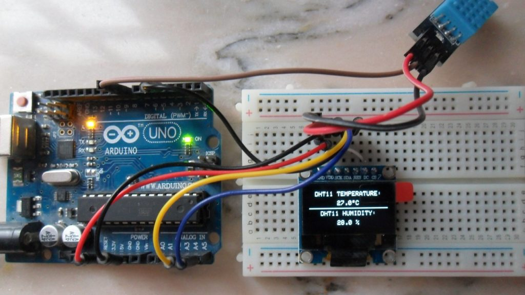 Arduino UNO with DHT11 sensor and SSD1306 OLED 128x64