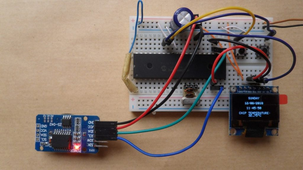 PIC16F877A with DS3231 RTC and I2C SSD1306 OLED display